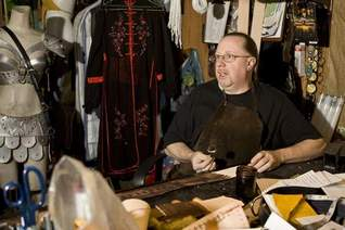 Leather crafter Chip Lorimer works on a belt in his workshop.